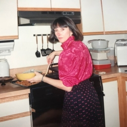 Auntie Ela working hard to put on Christmas Eve dinner - circa 1990.